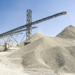 Working belt conveyors and a piles of rubble in Gravel Quarry, CR AdobeStock_122947485_isabela66